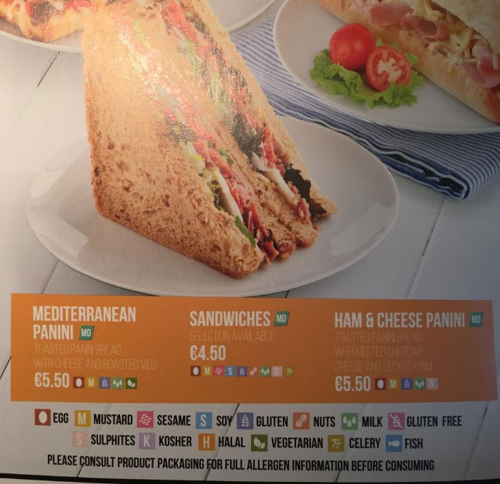 """Photo by ENAT: Ryanair in-flight menu with information on food allergens and special diets. (Note pictograms and additional text: """"Please consult product packaging for full allergen information before consuming"""")."""