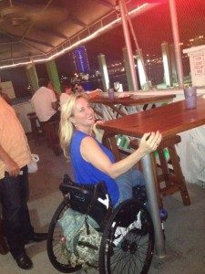 Picture 2. Women in a wheelchair tries the regular table at the restaurant.